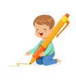cute little boy sitting on his knees and writing vector image vector image