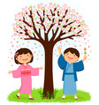 kids in kimonos standing under a sakura tree vector image