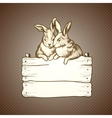 couple of easter rabbits on brown dots background