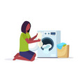 woman putting dirty clothes into washing machine vector image