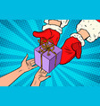 santa claus gives christmas gift vector image