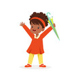cute happy black little girl standing and holding vector image vector image