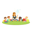 teacher reading a fairytale to kids while sitiing vector image vector image