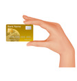 hand with gold credit card vector image