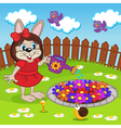 rabbit girl watering flowers in flowerbed vector image