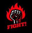 clenched raised fist in fire on dark black vector image