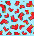 seamless background pattern with cartoon socks vector image