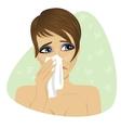 Woman sneezing into her handkerchief vector image