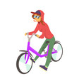 young woman in red hoodie enjoying cycling sport vector image