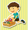 Boy putting toys in the box vector image vector image