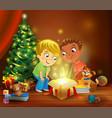 christmas miracle - boys opening a magic gift vector image