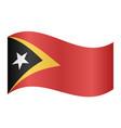 flag of east timor waving on white background vector image vector image