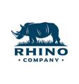 rhinoceros logo on grass vector image vector image