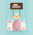 Cute rabbits with easter eggs painted and chick