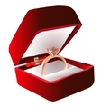 Gold ring with pink gemstone in Red Velvet Box vector image