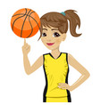 teenager girl spinning basketball ball with finger vector image vector image