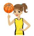 teenager girl spinning basketball ball with finger vector image