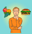 man choice between fast food and fruit vector image