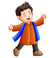 happy boy in orange winter clothes vector image