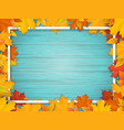 autumn leaves and frame on old wooden background vector image vector image