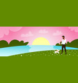 young man walking with dog outdoors at park guy vector image