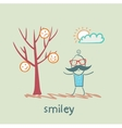 a man stands next to a tree on which grow smilies vector image vector image