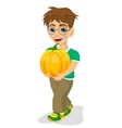 Cute little boy carrying a large pumpkin smiling vector image