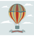 vintage hot air balloon in the sky with clouds vector image vector image