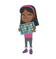 african girl playing game on a tablet computer vector image vector image