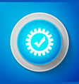 white gear with check mark icon on blue background vector image vector image