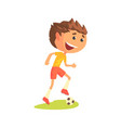 young soccer player kicking the ball cartoon vector image