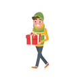 boy with packed present in hat and scarf vector image vector image