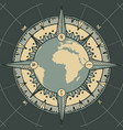 planet earth with a wind rose and old compass