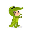 cartoon child in funny crocodile costume boy or vector image vector image
