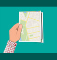folded paper city map in hand vector image vector image