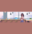 businesswoman sitting on chair at bar counter