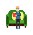 senior man sitting on the green sofa and reading a vector image vector image