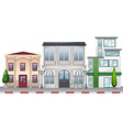 Shops and buildings along the road vector image vector image