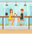 two young women sitting in cafe and drinking vector image vector image