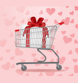 shopping cart with present inside vector image