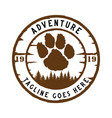 wolf footprints and pine forest adventure logos vector image vector image