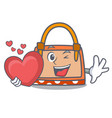with heart hand bag mascot cartoon vector image vector image