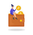 woman putting a bitcoin in her wallet flat vector image vector image