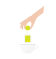 Human hand is holding tea bag vector image vector image