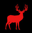 red silhouette of reindeer with big horns on vector image