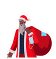 santa claus holding sack full gifts new year vector image