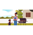 mother and son preparing hot dogs on grill happy vector image