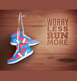 pair leather sports shoes on wood background vector image vector image