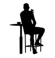 man silhouette sitting at a table in cafe bar vector image vector image