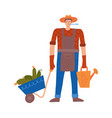 happy young gardener man with a wheelbarrow vector image